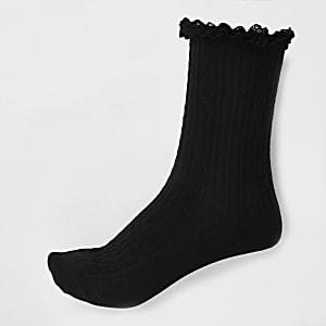 Chaussettes en maille torsadée noires à volant
