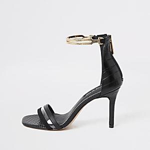 Zwarte sandalen met hoge hak en goudkleurige enkelband