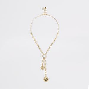 Halskette in Goldoptik mit Münzanhänger