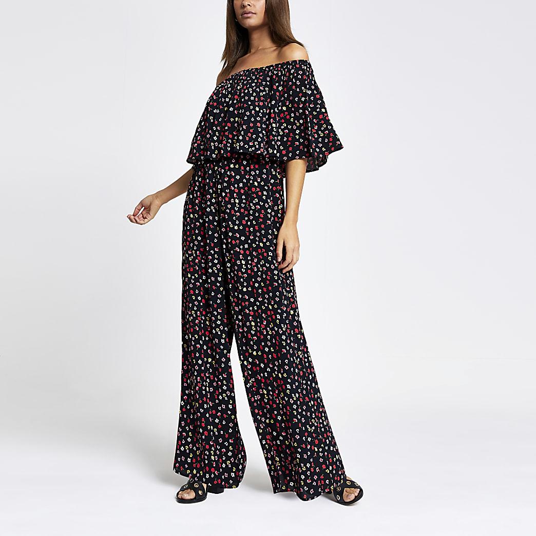 Zwarte jumpsuit met verfijnde bloemenprint in bardotstijl