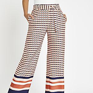Roze broek met wijde pijpen en geometrische print