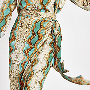 Turquoise midirok met slangenprint en overslag