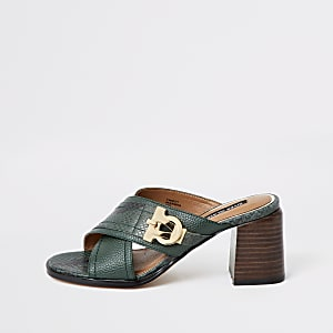 Dark green cross strap block heel mules