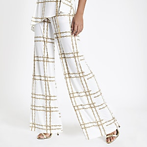 White chain print flared pants