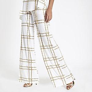 Witte wijduitlopende broek met kettingprint