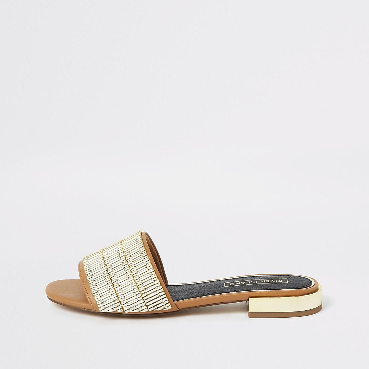 Bruine verfraaide sandalen