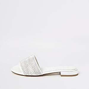 Sandales blanches avec ornements