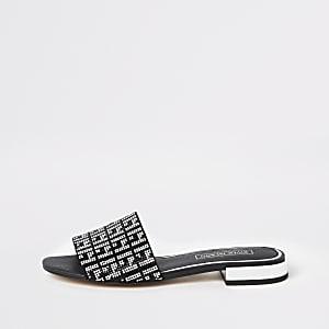 Zwarte verfraaide platte sandalen
