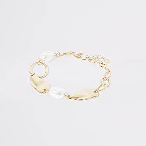 Bracelet de cheville doré à perles