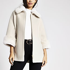 Kiezelkleurige jas met rand van imitatiebont en rits voor