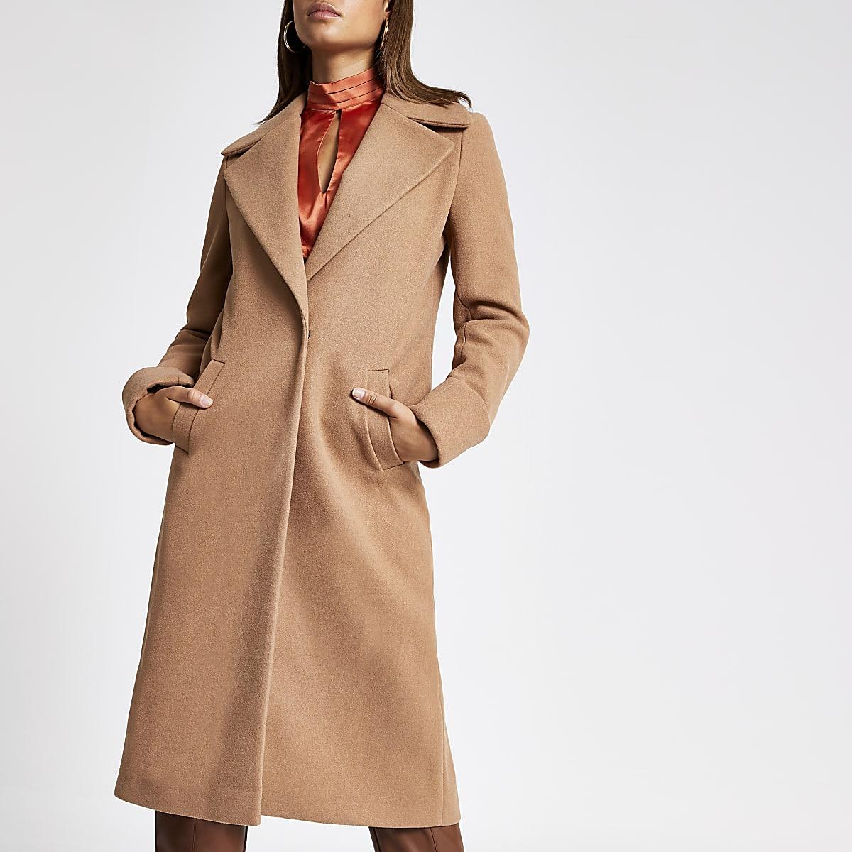 Beige lange jas met omgeslagen mouwen