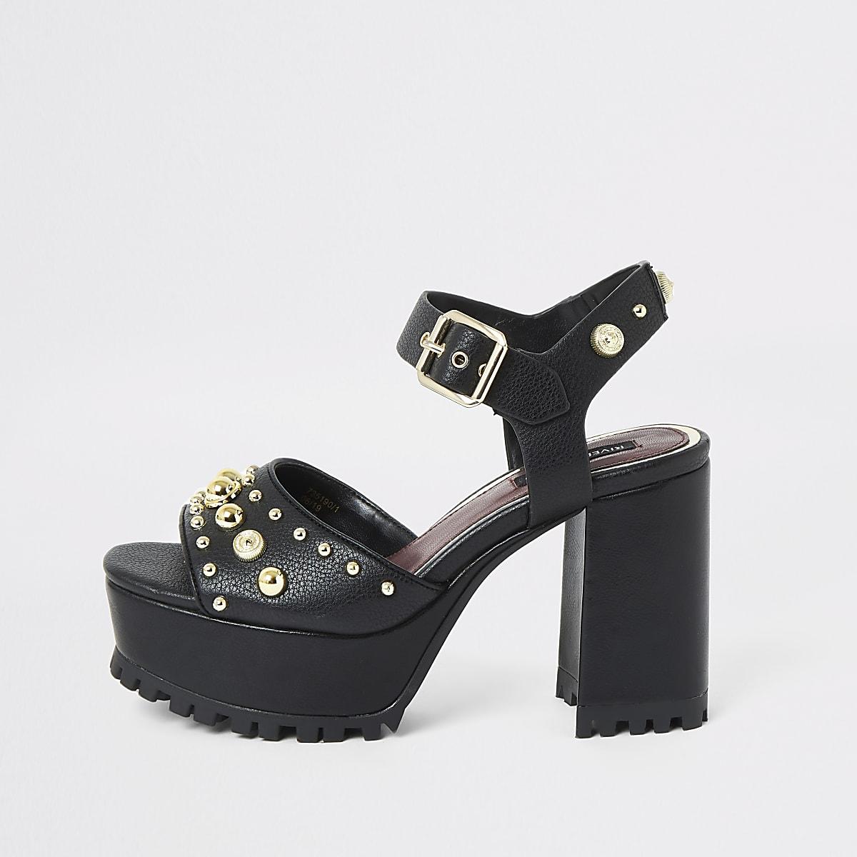 Zwarte sandalen met studs en plateauzolen met profiel