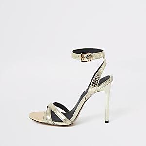 Chaussures dorées à talon aiguille