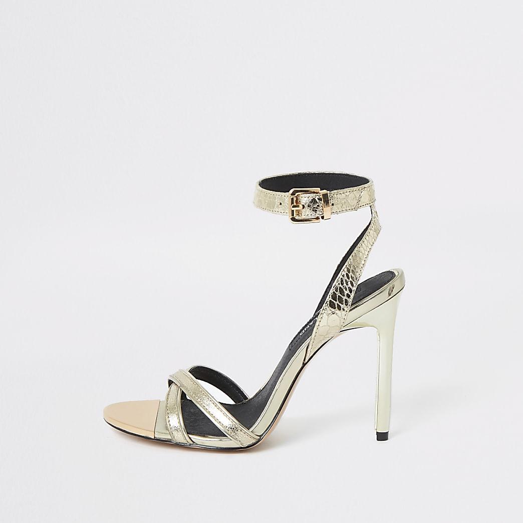 Goudkleurige schoenen met hoge smalle hak