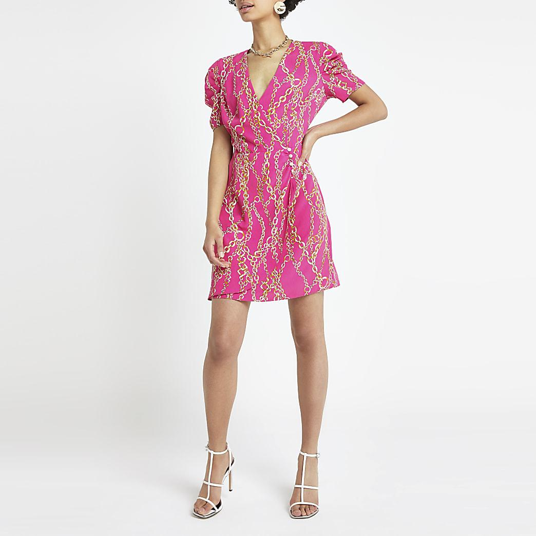Roze jurk met kettingprint en pofmouwen