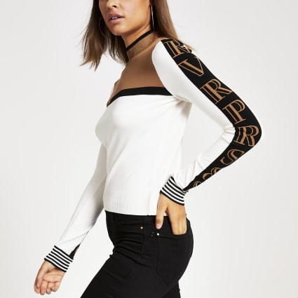 Beige block print long sleeve fitted knit top