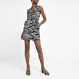 Beige bodyconjurk met riem en zebraprint
