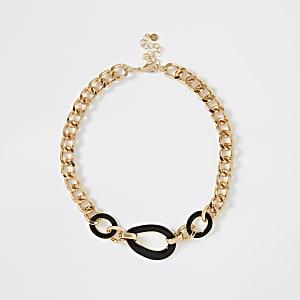 Goldene, klobige Halskette