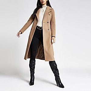 Beige lange double breasted jas met ceintuur