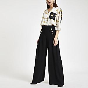 Pantalon large noir plissé sur le devant