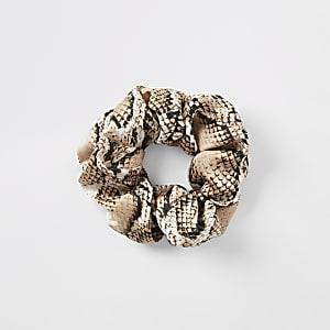 Beiges Haargummi in Schlangenlederoptik