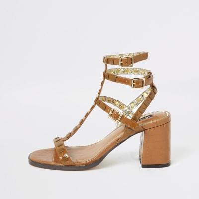 Brown studded gladiator block heel sandals
