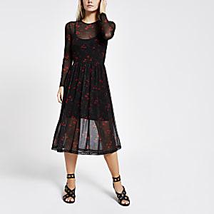 Zwarte geplooide jurk met bloemenprint en mesh