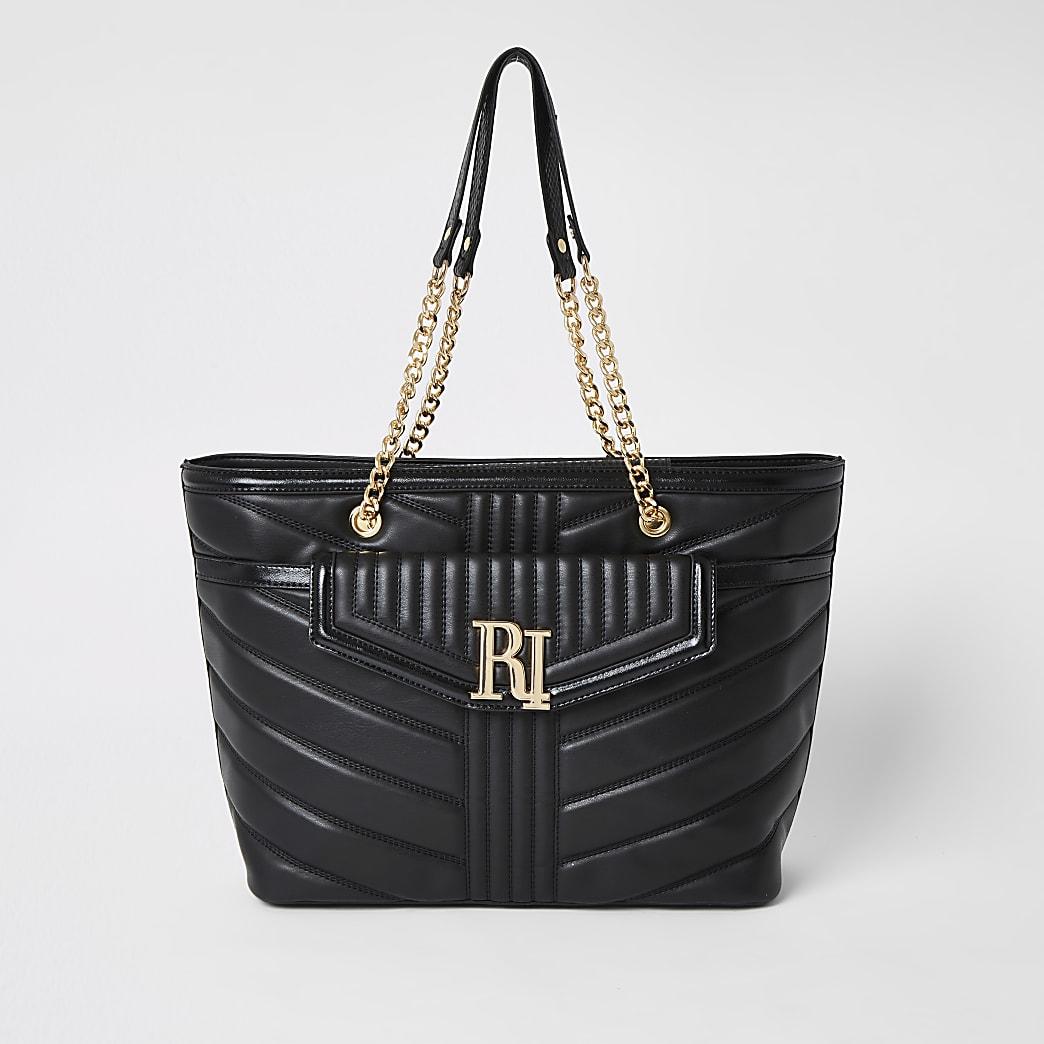Black quilted RI pocket shoulder bag