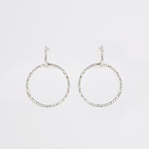 Zilverkleurige oorbellen met diamantjes en ring