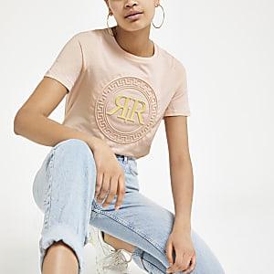 Roze T-shirt met RI-logo en reliëf