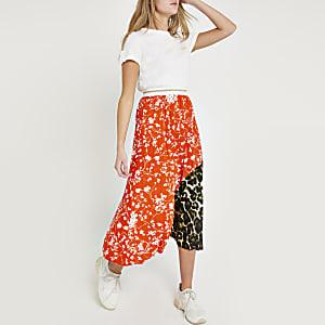 Jupe mi-longue plissée à imprimé petites fleurs orange
