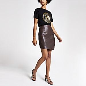 Mini jupe en cuir asymétrique bordeaux