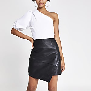 Black asymmetric leather mini skirt