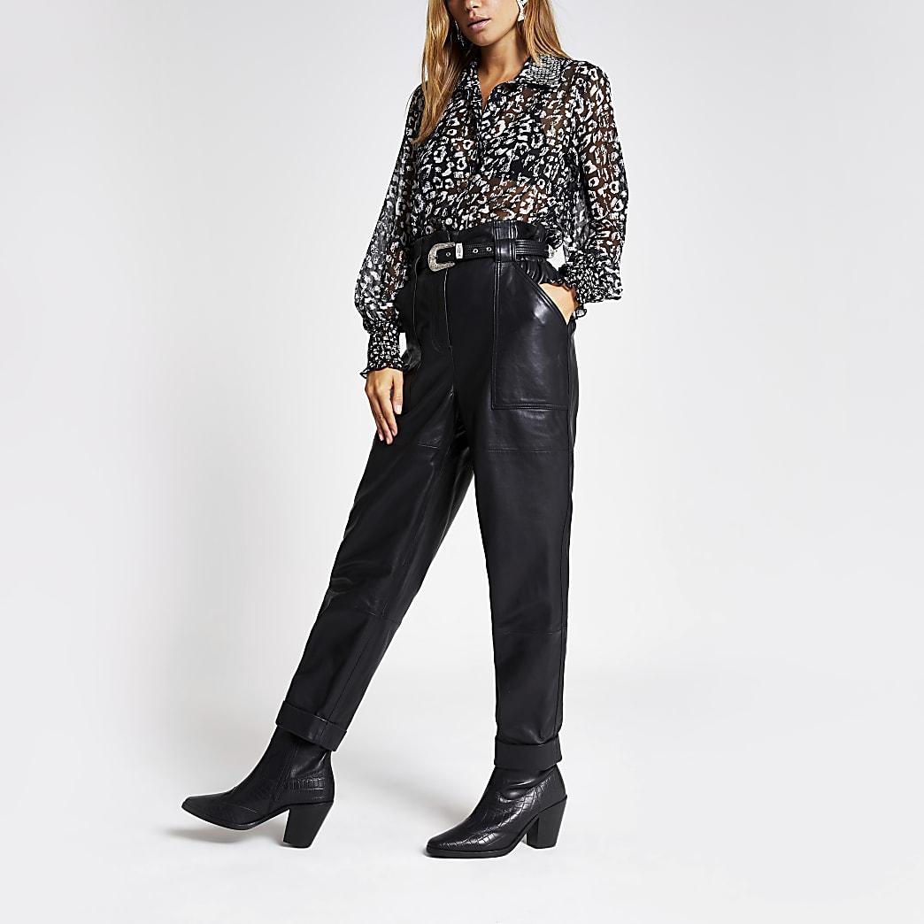 Pantalon en cuir noir à taille haute ceinturée