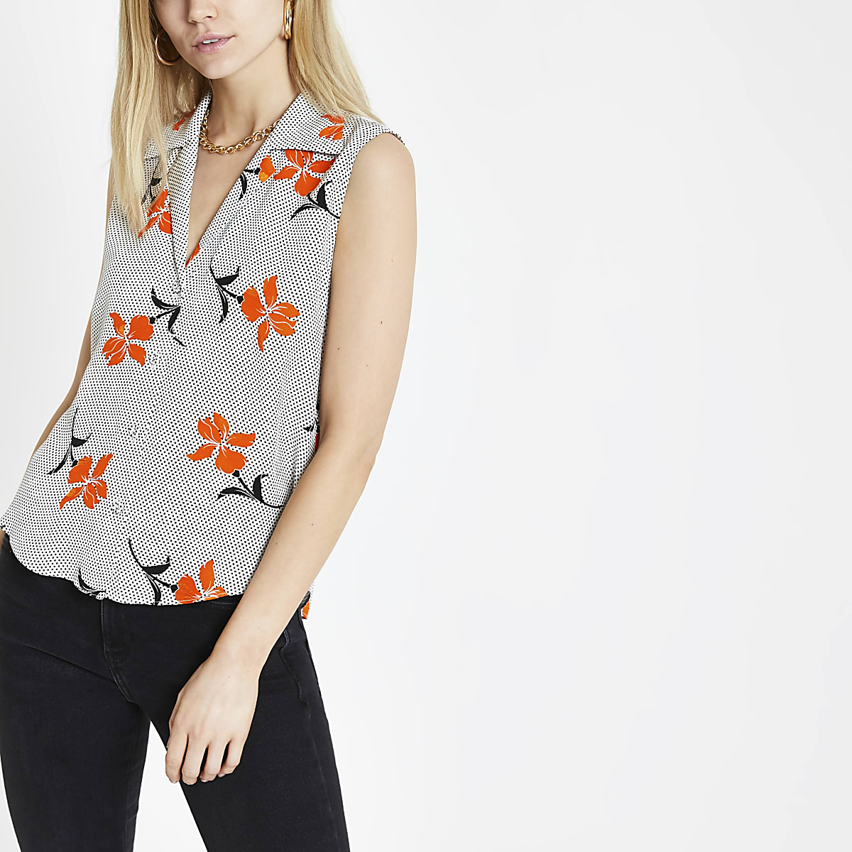 Orange floral spot print sleeveless shirt