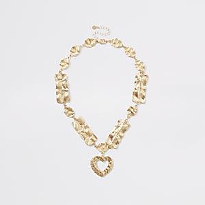 Goldfarbene Halskette mit Herzanhänger