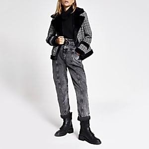 Schwarze Jacke mit Hahnentritt-Muster und Kunstfellbesatz