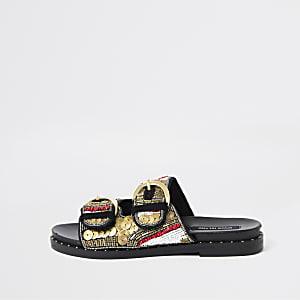 Schwarze Sandalen mit Perlenverzierung