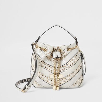 Cream studded mini duffle bag