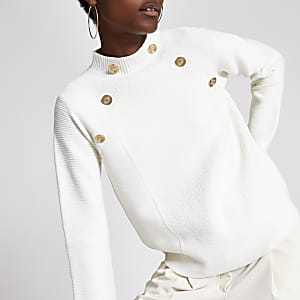 Crèmekleurige pullover met knoopjesdetail