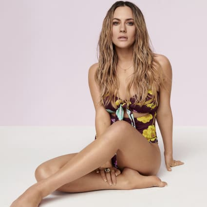 Caroline Flack purple floral swimsuit