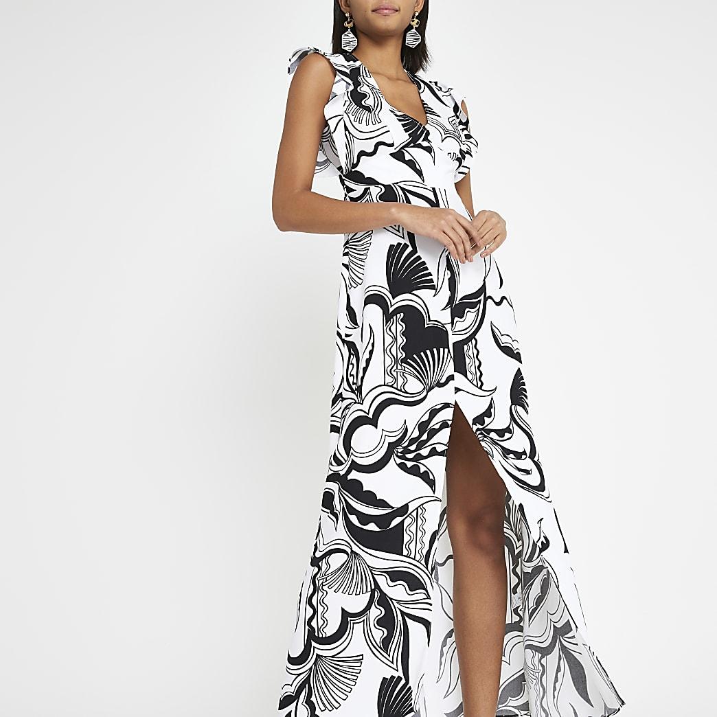 Zwarte jurk met print en split in de zoom