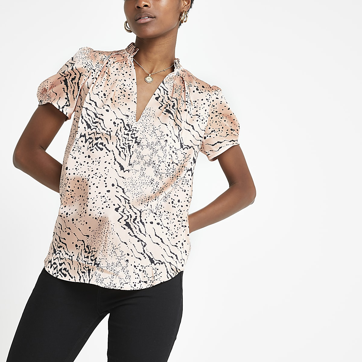 Pink animal print V neck shell top