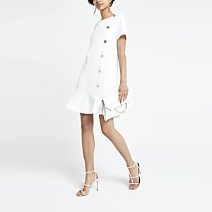 White peplum hem dress