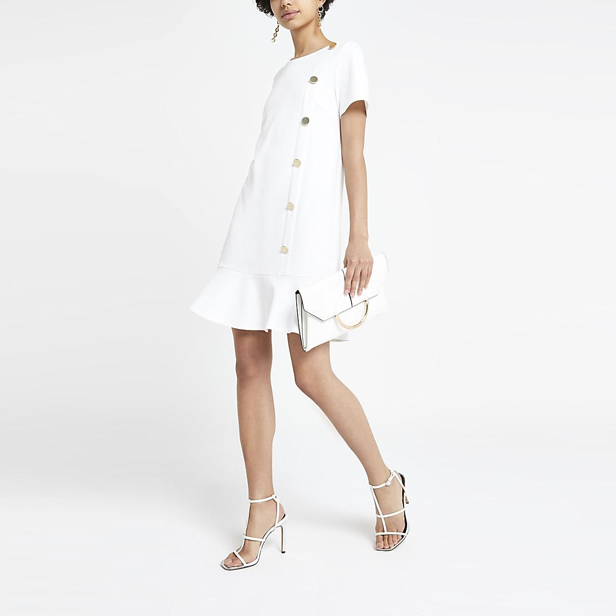 White peplum hem dress