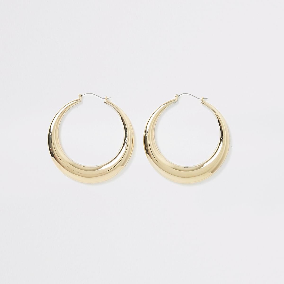 Gold color statement hoop earrings