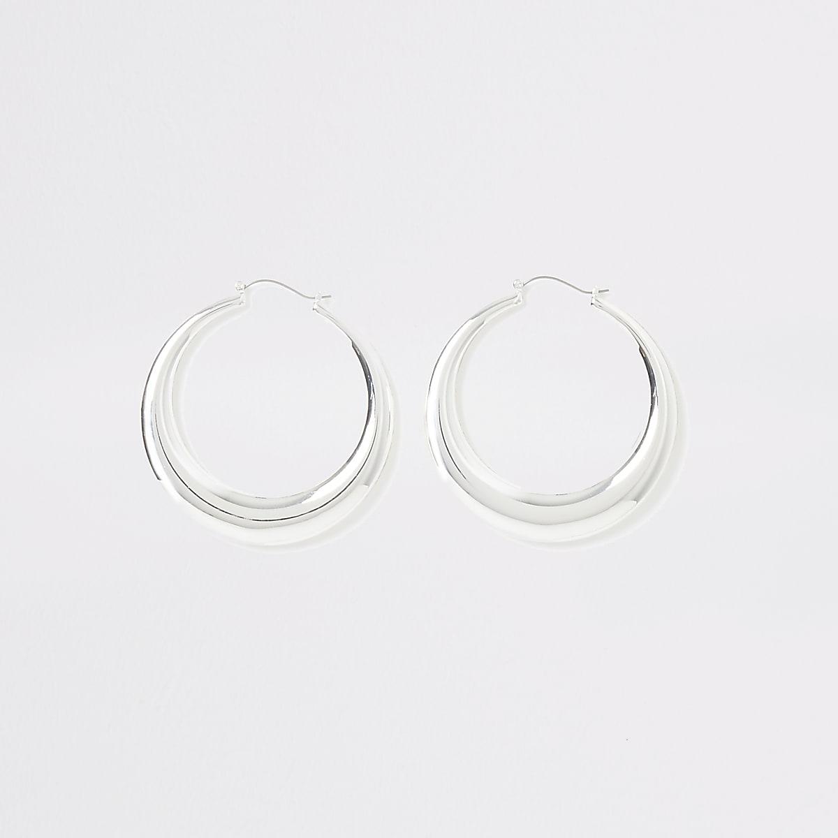 Silver color hoop statement earrings