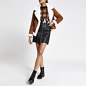 Black faux leather utility mini skirt