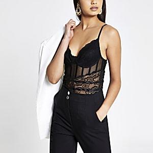 Zwarte kanten bodysuit met doorschijnende vlakken