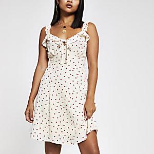 RI Petite - Beige cami-jurk met stippen en ruches
